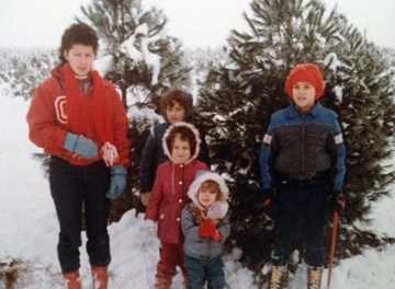 Me and my siblings. I am the completely normal one in the cute maroon coat.