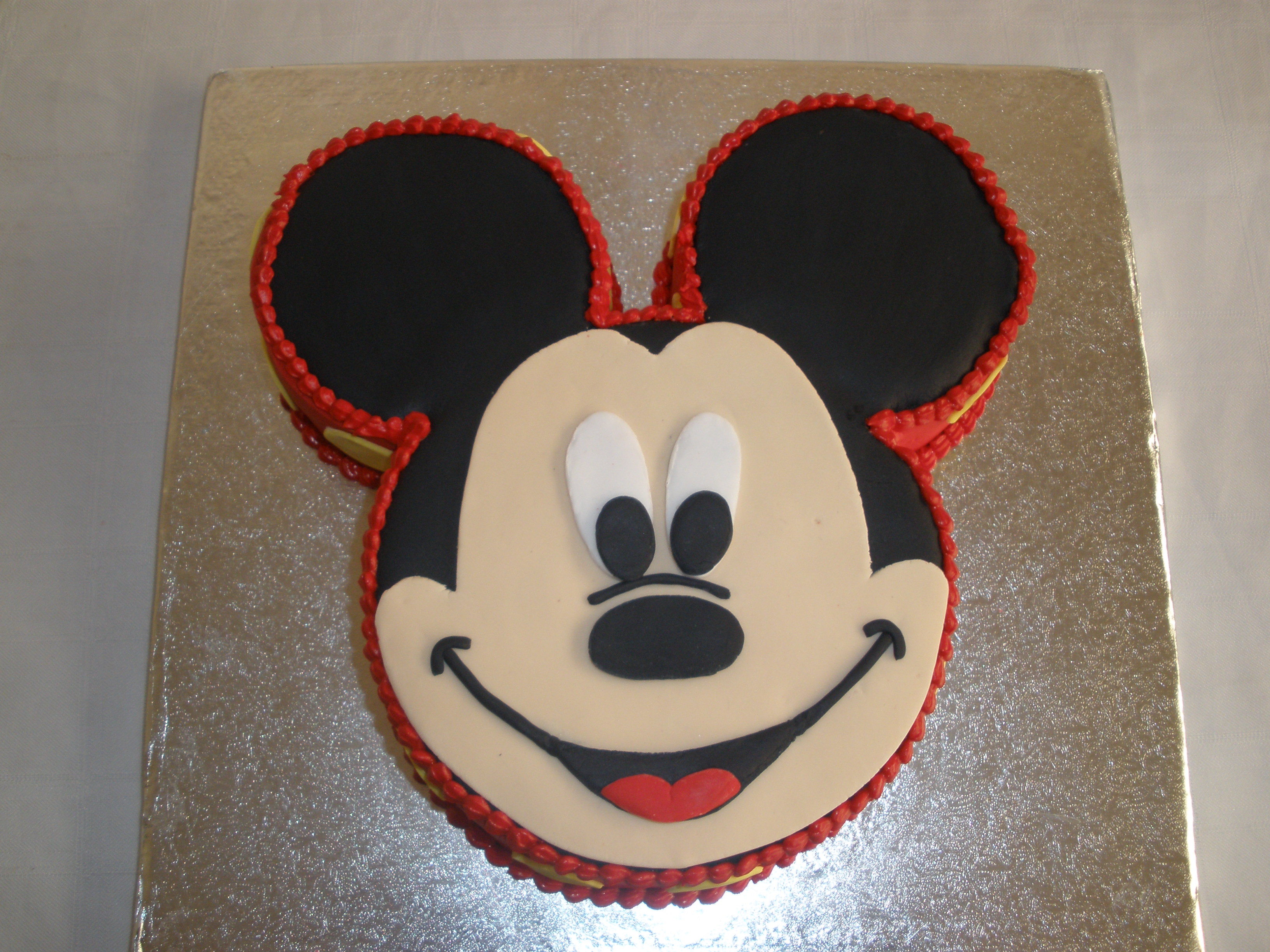 Mickey mouse outline cake ideas and designs for Mickey mouse face template for cake