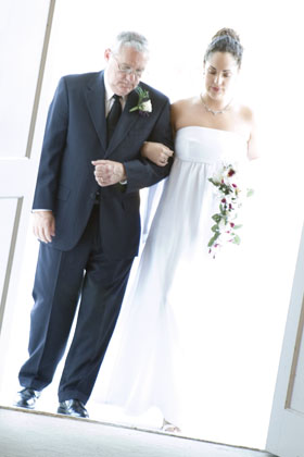 Walking down the aisle with my dad. One of my favorite photos ever.